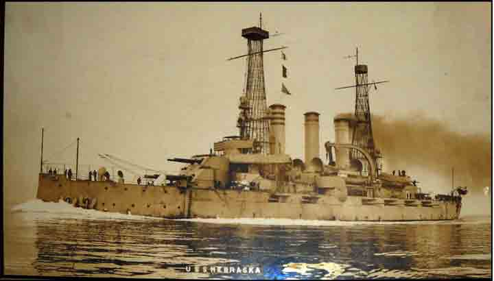 After the cruise, Nebraska was fitted with cage towers around the mast as shown in the photograph.